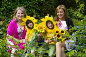 Sharon Foley, CEO of the Irish Hospice Foundation and RTE's Mary Kennedy joined by five-year-old twins Patrick and Keelin O'Farrell, at the launch of Hospice Sunflower Days 2013