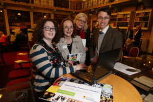 Holly Cooper digital archive assistant IHF guiding Janice Redmond, Gerardine Montgomery and Patrick Ussher Jnr through archive